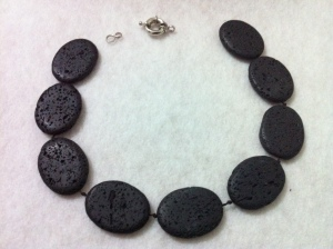 Flat ovals of lava rock with its lifesaver clasp