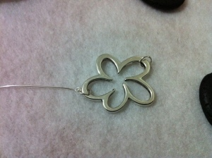 Flower Charm attached to an eye head pin with jump rings