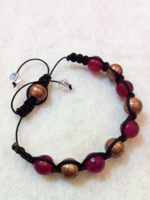 Red agate stones and glass coated bronze beads in a shamballa style bracelet